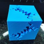 3D printed gear cube from PolyPrinter 229. File from Thingiverse
